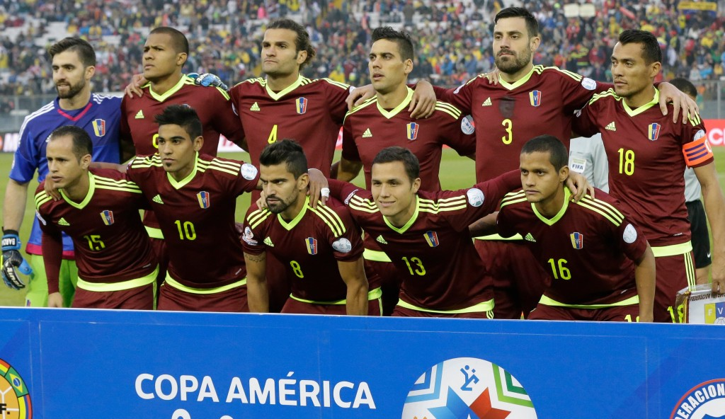 Venezuela's national soccer team pose for a group photo prior a Copa America Group C soccer match against Brazil at the Monumental stadium in Santiago, Chile, Sunday, June 21, 2015. (AP Photo/Jorge Saenz)
