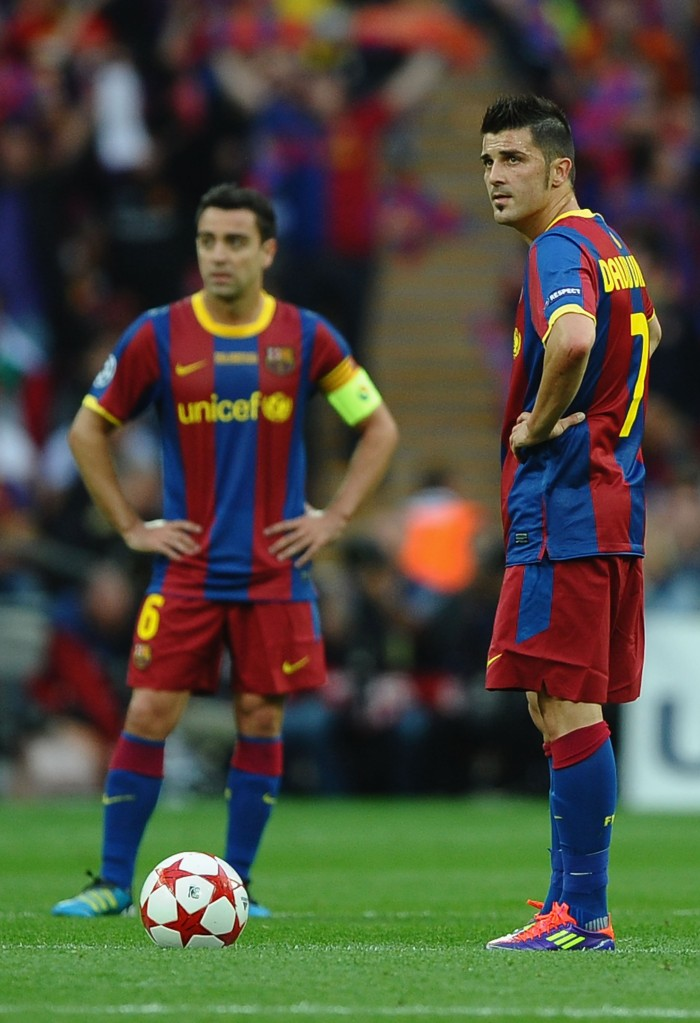 LONDON, ENGLAND - MAY 28: David Villa of FC Barcelona (R) and teammate Xavi wait to kick off after conceding a goal during the UEFA Champions League final between FC Barcelona and Manchester United FC at Wembley Stadium on May 28, 2011 in London, England. (Photo by Laurence Griffiths/Getty Images)