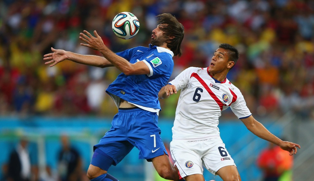 RECIFE, BRAZIL - JUNE 29: Giorgos Samaras of Greece controls the ball against Oscar Duarte of Costa Rica during the 2014 FIFA World Cup Brazil Round of 16 match between Costa Rica and Greece at Arena Pernambuco on June 29, 2014 in Recife, Brazil. (Photo by Ian Walton/Getty Images)