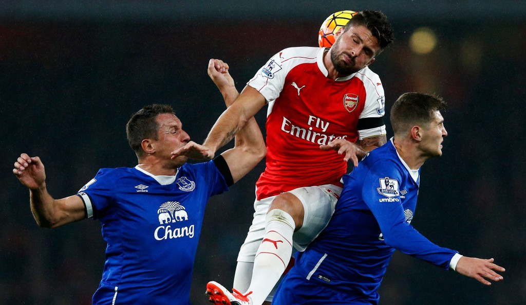 LONDON, ENGLAND - OCTOBER 24: Olivier Giroud (C) of Arsenal competes for the ball against Phil Jagielka (L) and John Stones (R) of Everton during the Barclays Premier League match between Arsenal and Everton at Emirates Stadium on October 24, 2015 in London, England. Photo by Dean Mouhtaropoulos/Getty Images) (Photo by Dean Mouhtaropoulos/Getty Images)