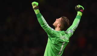 MANCHESTER, ENGLAND - MARCH 02: David De Gea of Manchester United celebrates the opening goal scored by Juan Mata (not pictured) during the Barclays Premier League match between Manchester United and Watford at Old Trafford on March 2, 2016 in Manchester, England. (Photo by Laurence Griffiths/Getty Images)
