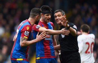 LONDON, ENGLAND - MARCH 06: Damien Delaney and Scott Dann of Crystal Palace appeal to referee Andre Marriner as he awards Liverpool a penalty during the Barclays Premier League match between Crystal Palace and Liverpool at Selhurst Park on March 6, 2016 in London, England. (Photo by Mike Hewitt/Getty Images)