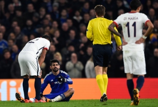 LONDON, ENGLAND - MARCH 09: Diego Costa of Chelsea goes down injured during the UEFA Champions League round of 16, second leg match between Chelsea and Paris Saint Germain at Stamford Bridge on March 9, 2016 in London, United Kingdom. (Photo by Mike Hewitt/Getty Images)