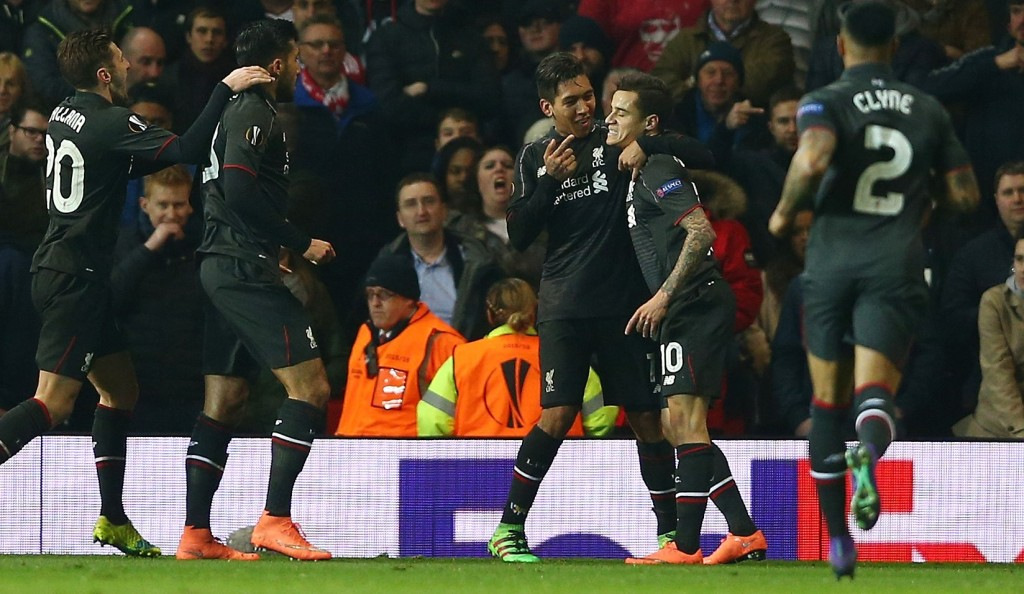 MANCHESTER, ENGLAND - MARCH 17: Philippe Coutinho of Liverpool (10) celebrates with team mates as he scores their first goal during the UEFA Europa League round of 16, second leg match between Manchester United and Liverpool at Old Trafford on March 17, 2016 in Manchester, England. (Photo by Clive Brunskill/Getty Images)