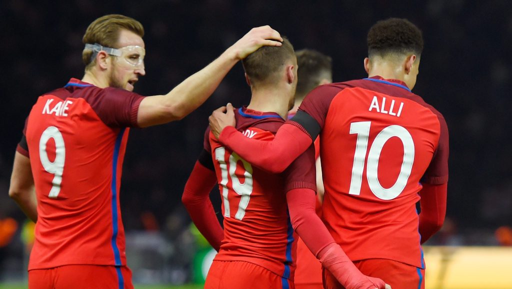 BERLIN, GERMANY - MARCH 26: Jamie Vardy (2nd L) of England celebrates scoring his team's second goal with his team mates Harry Kane (1st L), Dele Alli (2nd R) of England during the International Friendly match between Germany and England at Olympiastadion on March 26, 2016 in Berlin, Germany. (Photo by Mike Hewitt/Getty Images)