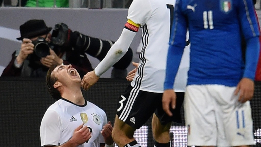 MUNICH, GERMANY - MARCH 29: Mario Gotze of Germany (L) celebrates after scoring the second goal during the international friendly match between Germany and Italy at Allianz Arena on March 29, 2016 in Munich, Germany. (Photo by Claudio Villa/Getty Images)