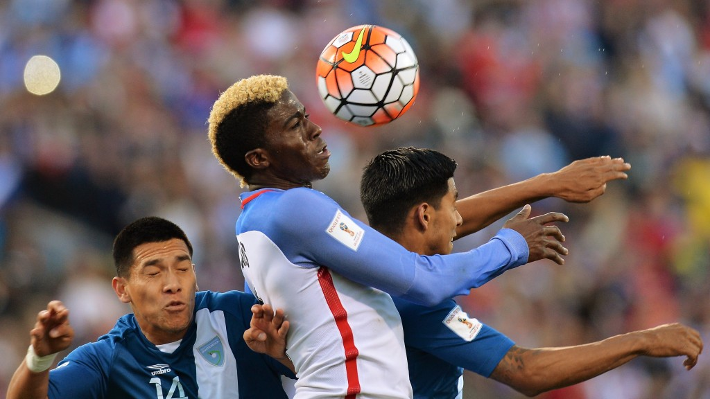 COLUMBUS, OH - MARCH 29: Gyasi Zardes #9 of the United States Men's National Team gets control of the ball around Rafael Morales #14 of Guatemala and Moises Hernandez #5 of Guatemala in the first half to assist on Clint Dempsey #8 of the United States Men's National Team's goal during the FIFA 2018 World Cup qualifier on March 29, 2016 at MAPFRE Stadium in Columbus, Ohio. (Photo by Jamie Sabau/Getty Images)