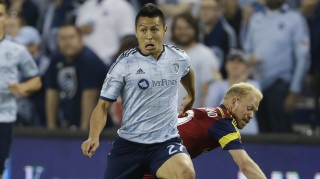 Sporting KC midfielder Roger Espinoza (27) breaks away from Real Salt Lake midfielder Luke Mulholland, back, during the first half of an MLS soccer match in Kansas City, Kan., Saturday, April 11, 2015. (AP Photo/Orlin Wagner)