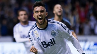 Vancouver Whitecaps' Pedro Morales, of Chile, celebrates after scoring a goal on a penalty kick against NYC FC during the second half of an MLS soccer match in Vancouver, British Columbia, on Saturday, Sept. 26, 2015. (Darryl Dyck/The Canadian Press via AP)