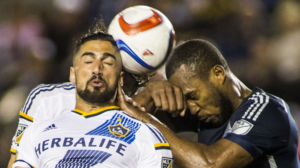 Los Angeles Galaxy midfielder Sebastian Lletget, left, and Vancouver Whitecaps defender Kendall Waston fight for a head ball in the second half of an MLS soccer game at StubHub Center in Carson, Calif., Saturday, June 6, 2015. The Whitecaps won 1-0. (AP Photo/Ringo H.W. Chiu)