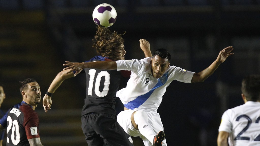 United States' Mix Diskerud, center left, and Guatemala's Gerson Tinoco go for the ball during a 2018 Russia World Cup qualifying soccer match at Mateo Flores Stadium in Guatemala City, Friday, March 25, 2016. (AP Photo/ Moises Castillo)