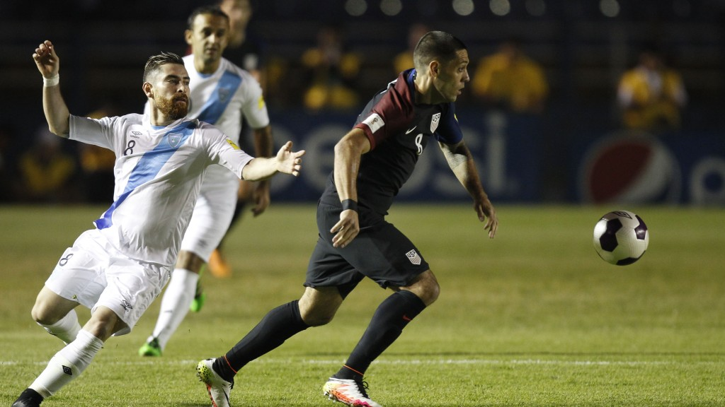 United States' Clint Dempsey, right, controls the ball against Guatemala's Jean Marquez during a 2018 Russia World Cup qualifying soccer match at Mateo Flores Stadium in Guatemala City, Friday, March 25, 2016. (AP Photo/ Moises Castillo)