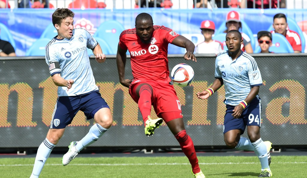 Sporting Kansas City's Matt Besler, left, vies for the ball with Toronto FC's Jozy Altidore as Sporting KC's Jimmy Medranda, right, chases during the first half of an MLS soccer match in Toronto on Saturday, Aug. 8, 2015. (Frank Gunn /The Canadian Press via AP) MANDATORY CREDIT