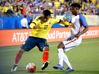 Colombia forward Roger Martinez (17) works against U.S. defender Kellyn Acosta (2) for space during the first half of an Olympic qualifying soccer match Tuesday, March 29, 2016, in Frisco, Texas. (AP Photo/Brandon Wade)