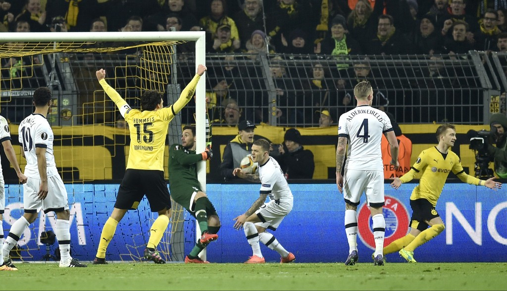 Dortmund's Marco Reus, right, celebrates after scoring his side's 2nd goal during the Europa League round of 16 first leg soccer match between Borussia Dortmund and Tottenham Hotspur in Dortmund, Germany, Thursday, March 10, 2016. (AP Photo/Martin Meissner)