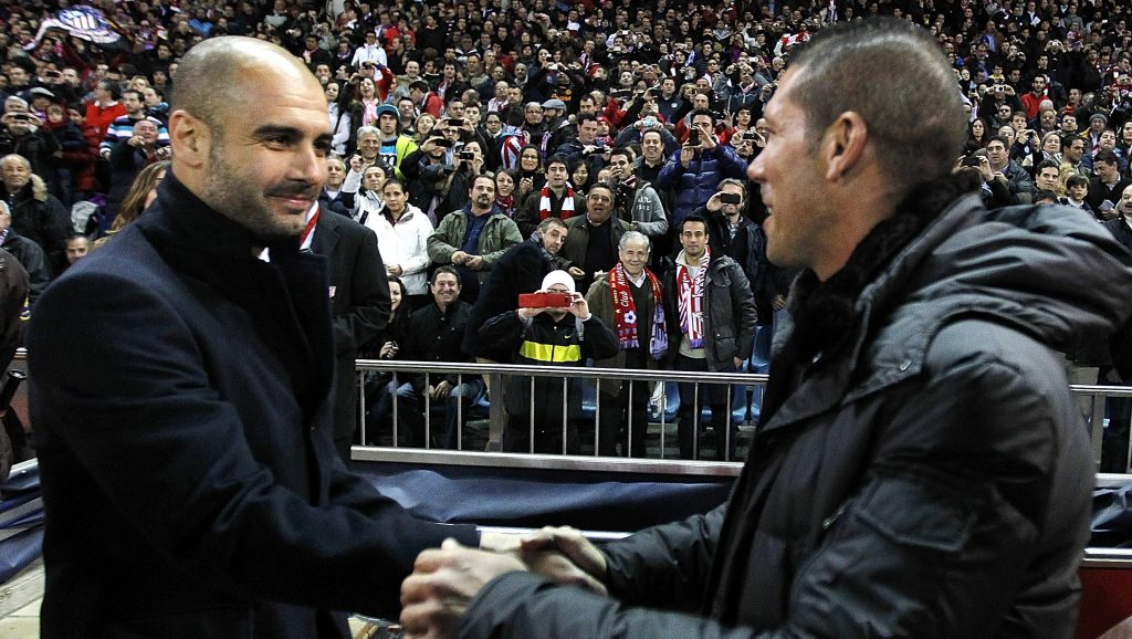 MADRID, SPAIN - FEBRUARY 26: Head coach Josep Guardiola (L) of Barcelona shakes hands with head coach Diego Simeone of Atletico Madrid prior of the La Liga match at Vicente Calderon Stadium on February 26, 2012 in Madrid, Spain. (Photo by Angel Martinez/Getty Images)