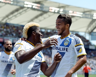 CARSON CA - AUGUST 9: Making his MLS debut Giovani Dos Santos #10 of the Los Angeles Galaxy congratulates Gyasi Zardes #11 after he scored a goal against Seattle Sounders during the first half at StubHub Center August 9, 2015, in Carson, California. (Photo by Kevork Djansezian/Getty Images)