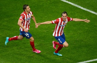 LISBON, PORTUGAL - MAY 24:  Diego Godin of Club Atletico de Madrid celebrates scoring the opening goal with Gabi of Club Atletico de Madrid during the UEFA Champions League Final between Real Madrid and Atletico de Madrid at Estadio da Luz on May 24, 2014 in Lisbon, Portugal.  (Photo by Lars Baron/Getty Images)