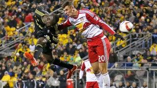 COLUMBUS, OH - NOVEMBER 22: Kei Kamara #23 of the Columbus Crew SC heads the ball past Matt Miazga #20 of the New York Red Bulls during the first half on November 22, 2015 at MAPFRE Stadium in Columbus, Ohio. (Photo by Kirk Irwin/Getty Images)