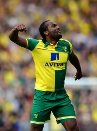 NORWICH, ENGLAND - APRIL 02: Cameron Jerome of Norwich City celebrates at the final whistle during the Barclays Premier League match between Norwich City and Newcastle United at Carrow Road on April 2, 2016 in Norwich, England. (Photo by Dan Mullan/Getty Images)