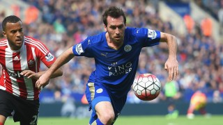 LEICESTER, ENGLAND - APRIL 03: Christian Fuchs of Leicester City is chased by Ryan Bertrand of Southampton during the Barclays Premier League match between Leicester City and Southampton at The King Power Stadium on April 3, 2016 in Leicester, England. (Photo by Michael Regan/Getty Images)