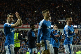 GLASGOW, SCOTLAND - APRIL 5 : Rangers players celebrate on the pitch as Rangers beat Dumbarton 1-0 to clinch the Scottish Championship title during the match between Glasgow Rangers FC and Dumbarton FC at Ibrox Stadium on April 5, 2016 in Glasgow, Scotland. (Photo by Mark Runnacles/Getty Images)