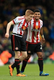 NORWICH, ENGLAND - APRIL 16: Duncan Watmore (L) of Sunderland celebrates scoring his team's third goal with DeAndre Yedlin during the Barclays Premier League match between Norwich City and Sunderland at Carrow Road on April 16, 2016 in Norwich, England. (Photo by Stephen Pond/Getty Images)