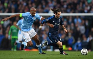 MANCHESTER, ENGLAND - APRIL 26: Gareth Bale of Real Madrid CF is challenged by Vincent Kompany of Manchester City during the UEFA Champions League Semi Final first leg match between Manchester City FC and Real Madrid at the Etihad Stadium on April 26, 2016 in Manchester, United Kingdom. (Photo by Shaun Botterill/Getty Images)