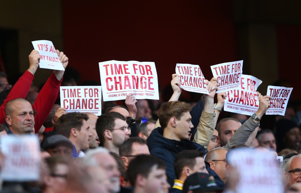 LONDON, ENGLAND - APRIL 30: Arsenal supportes hold banners 'Time For Change' during the Barclays Premier League match between Arsenal and Norwich City at The Emirates Stadium on April 30, 2016 in London, England (Photo by Paul Gilham/Getty Images)