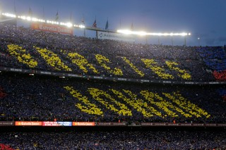 Fans hold up amosaic of 90,000 cards with the slogan reading in Catalan: ''Thank you Johan' during a tribute to the late Dutch soccer star Johan Cruyff. (AP Photo/Emilio Morenatti)