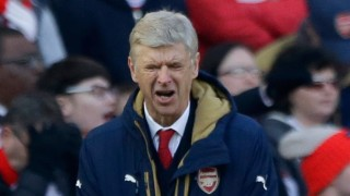 Arsenal's French manager Arsene Wenger reacts in frustration during the second half of the English FA Cup quarterfinal soccer match between Arsenal and Watford at the Emirates stadium in London, Sunday, March 13, 2016. (AP Photo/Matt Dunham)
