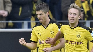 Dortmund's Christian Pulisic, left, celebrates with Felix Passlack, right, after scoring the opening goal during the German Bundesliga soccer match between Borussia Dortmund and Hamburger SV in Dortmund, Germany, Sunday, April 17, 2016. (AP Photo/Martin Meissner)