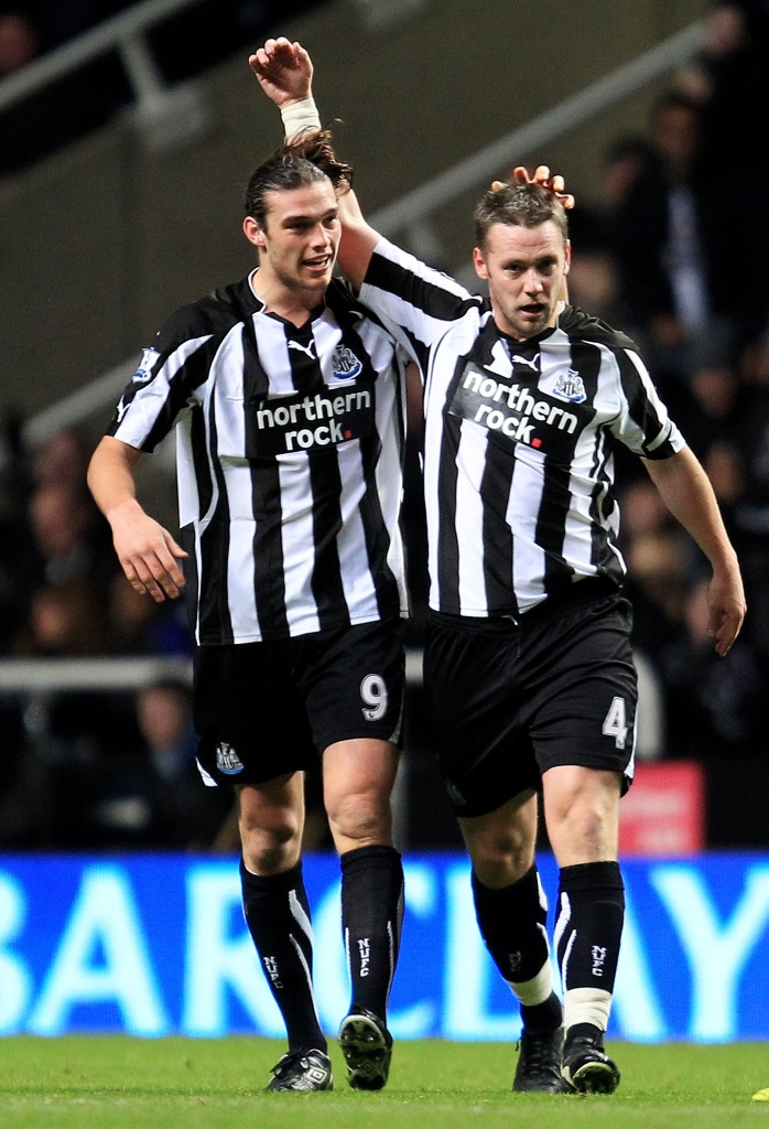 NEWCASTLE UPON TYNE, ENGLAND - DECEMBER 11: Kevin Nolan of Newcastle United celebrates scoring the opening goal with team mate Andy Carroll (L) during the Barclays Premier League match between Newcastle United and Liverpool at St James' Park on December 11, 2010 in Newcastle, England. (Photo by Mark Thompson/Getty Images)