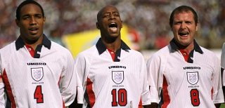 27 May 1998: Captain, Paul Ince of England and Liverpool sings the National Anthem with fellow team-mates Ian Wright and Paul Gascogne during the match between Morocco v England in the King Hassan II Cup played in Casablanca, Morocco. England won the match 1-0. Mandatory Credit: Shaun Botterill /Allsport