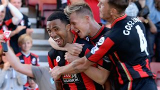 BOURNEMOUTH, ENGLAND - SEPTEMBER 19: Callum Wilson (L) of A.F.C. Bournemouth celebrates scoring their first goal with Matt Ritchie and Dan Gosling during the Barclays Premier League match between A.F.C. Bournemouth and Sunderland at the Vitality Stadium on September 19, 2015 in Bournemouth, United Kingdom. (Photo by Tony Marshall/Getty Images)