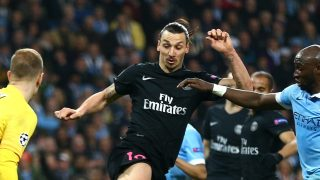 MANCHESTER, ENGLAND - APRIL 12: Zlatan Ibrahimovic of Paris Saint-Germain beats Eliaquim Mangala (20) and Joe Hart of Manchester City to score, but his goal is disallowed during the UEFA Champions League quarter final second leg match between Manchester City FC and Paris Saint-Germain at the Etihad Stadium on April 12, 2016 in Manchester, United Kingdom. (Photo by Clive Brunskill/Getty Images)