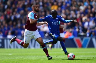 LEICESTER, ENGLAND - APRIL 17: Ngolo Kante of Leicester City holds off pressure from Winston Reid of West Ham United during the Barclays Premier League match between Leicester City and West Ham United at The King Power Stadium on April 17, 2016 in Leicester, England. (Photo by Dan Mullan/Getty Images)