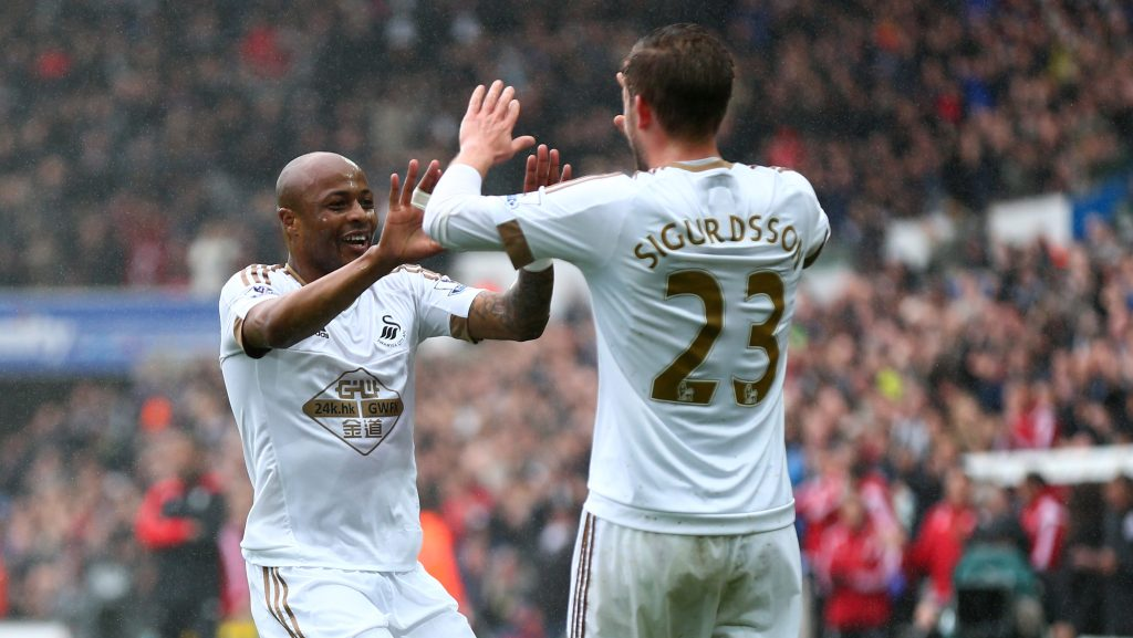 SWANSEA, WALES - MAY 01: Andre Ayew (L) of Swansea City celebrates scoring the opening goal with Gylfi Sigurdsson during the Barclays Premier League match between Swansea City and Liverpool at The Liberty Stadium on May 1, 2016 in Swansea, Wales. (Photo by Steve Bardens/Getty Images)