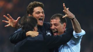 LONDON, ENGLAND - MAY 10: Slaven Bilic manager of West Ham United (R) celebrates victory with staff after the Barclays Premier League match between West Ham United and Manchester United at the Boleyn Ground on May 10, 2016 in London, England. West Ham United are playing their last ever home match at the Boleyn Ground after their 112 year stay at the stadium. The Hammers will move to the Olympic Stadium for the 2016-17 season. (Photo by Julian Finney/Getty Images)