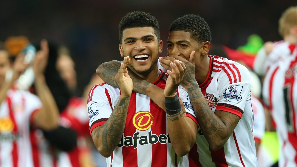 SUNDERLAND, ENGLAND - MAY 11: DeAndre Yedlin and Patrick van Aanholt of Sunderland celebrate staying in the Premier League after the Barclays Premier League match between Sunderland and Everton at the Stadium of Light on May 11, 2016 in Sunderland, England. (Photo by Ian MacNicol/Getty Images)