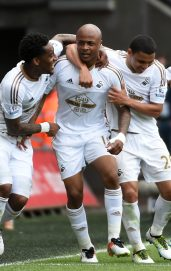 SWANSEA, WALES - MAY 15: Andre Ayew (2nd L) of Swansea City celebrates scoring his team's first goal with his team mates during the Barclays Premier League match between Swansea City and Manchester City at the Liberty Stadium on May 15, 2016 in Swansea, Wales. (Photo by Tom Dulat/Getty Images)