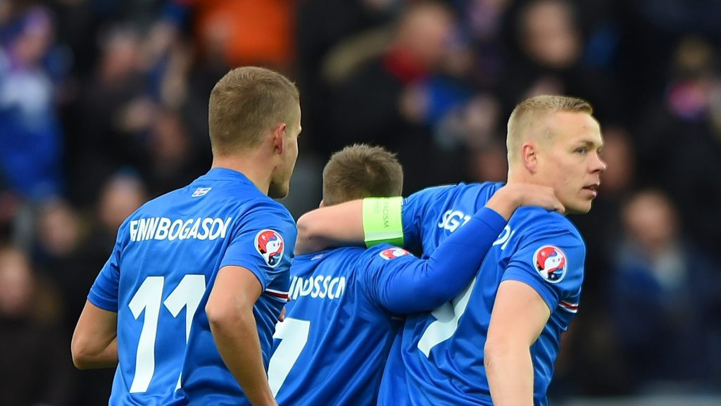 REYKJAVIK, ICELAND - OCTOBER 10: Kolbeinn Sightorsson (1st R) of Iceland celebrates scoring the opening goal during the UEFA EURO 2016 Qualifier match between Iceland and Latvia at Laugardalsvollur National Stadium on October 10, 2015 in Reykjavik, Iceland. (Photo by Tom Dulat/Getty Images).