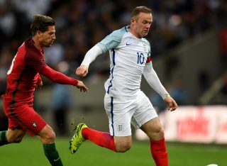 LONDON, ENGLAND - JUNE 02: Wayne Rooney of England is chased by Adrien Silva of Portugal during the international friendly match between England and Portugal at Wembley Stadium on June 2, 2016 in London, England. (Photo by Shaun Botterill/Getty Images)