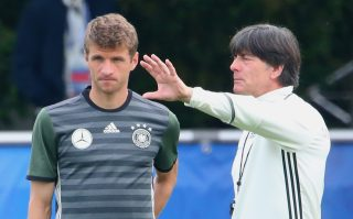 EVIAN-LES-BAINS, FRANCE - JUNE 09: Joachim Loew, head coach of the German national team talks to his player Thomas Mueller during a Germany training session ahead of the UEFA EURO 2016 at Ermitage Evian on June 9, 2016 in Evian-les-Bains, France. Germany's opening match at the European Championship is against Ukraine on June 12. (Photo by Alexander Hassenstein/Getty Images)