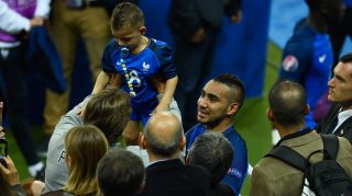 PARIS, FRANCE - JUNE 10: Dimitri Payet of France celebrate his team's win with his child after his team's 2-1 win in the UEFA Euro 2016 Group A match between France and Romania at Stade de France on June 10, 2016 in Paris, France. (Photo by Mike Hewitt/Getty Images)