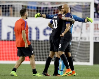 PHILADELPHIA, PA - JUNE 11: John Brooks #6,Brad Guzan #1 and Geoff Cameron #20 of United States celebrate the win over Paraguay after the Copa America Centenario Group C match at Lincoln Financial Field on June 11, 2016 in Philadelphia, Pennsylvania.The United States defeated Paraguay 1-0. (Photo by Elsa/Getty Images)