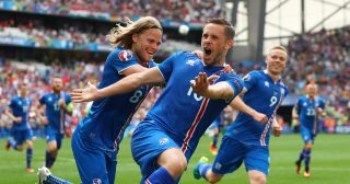 MARSEILLE, FRANCE - JUNE 18: Gylfi Sigurdsson of Iceland celebrates with Birkir Bjarnason of Iceland after scoring his team's first goal during the UEFA EURO 2016 Group F match between Iceland and Hungary at Stade Velodrome on June 18, 2016 in Marseille, France. (Photo by Lars Baron/Getty Images)
