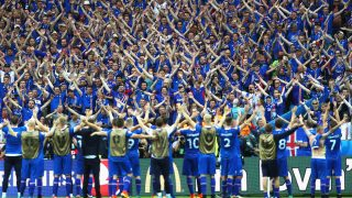 PARIS, FRANCE - JUNE 22: Iceland players celebrate with their fans after victory in the UEFA EURO 2016 Group F match between Iceland and Austria at Stade de France on June 22, 2016 in Paris, France. (Photo by Paul Gilham/Getty Images)