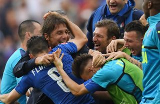 PARIS, FRANCE - JUNE 27: Antonio Conte head coach of Italy celebrates his team's 2-0 win with his team players and staffs after the UEFA EURO 2016 round of 16 match between Italy and Spain at Stade de France on June 27, 2016 in Paris, France. (Photo by Matthias Hangst/Getty Images)