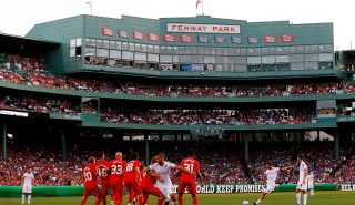 BOSTON, MA - JULY 25: Francesco Totti #10 of AS Roma takes a free kick against Liverpool during a pre-season tour friendly match on July 25, 2012 at Fenway Park in Boston, Massachusetts. (Photo by Jared Wickerham/Getty Images)